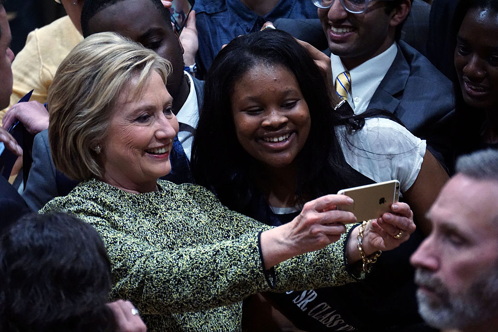 Hillary Clinton takes a selfie during a campaign rally in Durham, North Carolina at Hillside High School.