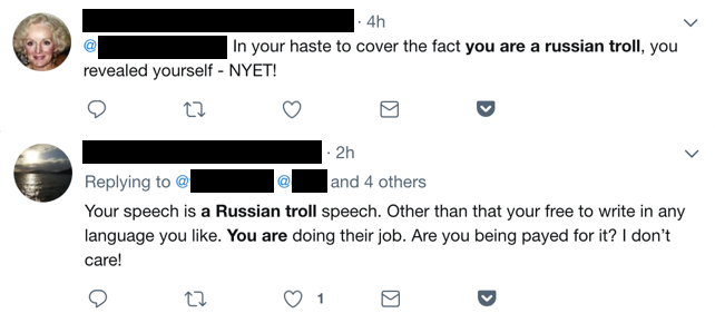 Twitter users accusing one another of being Russian trolls.
